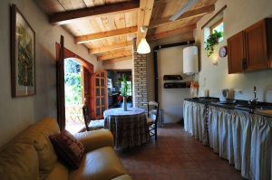 El Gallinero's kitchen/sitting area with French doors to terrace, passage to work/sleep area.